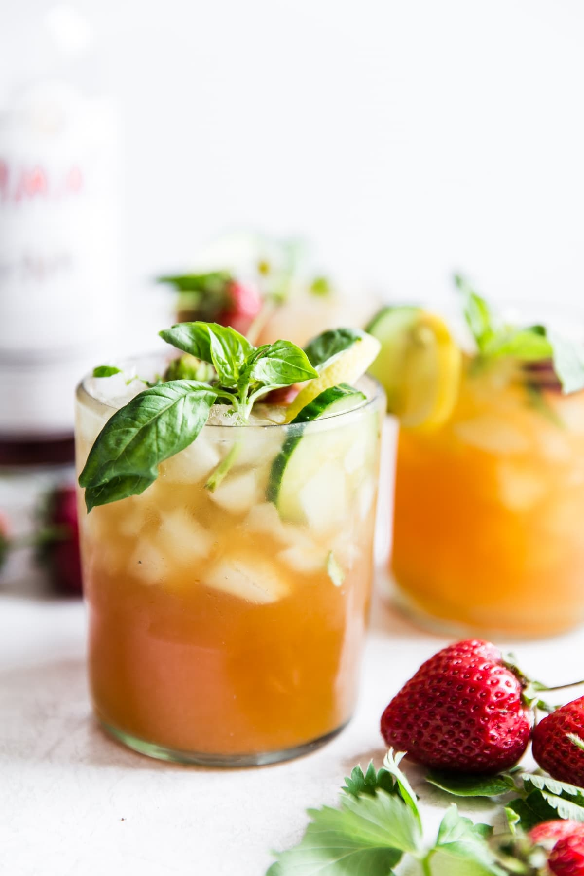 Pimm's Cup cocktail with strawberries, cucumber and basil