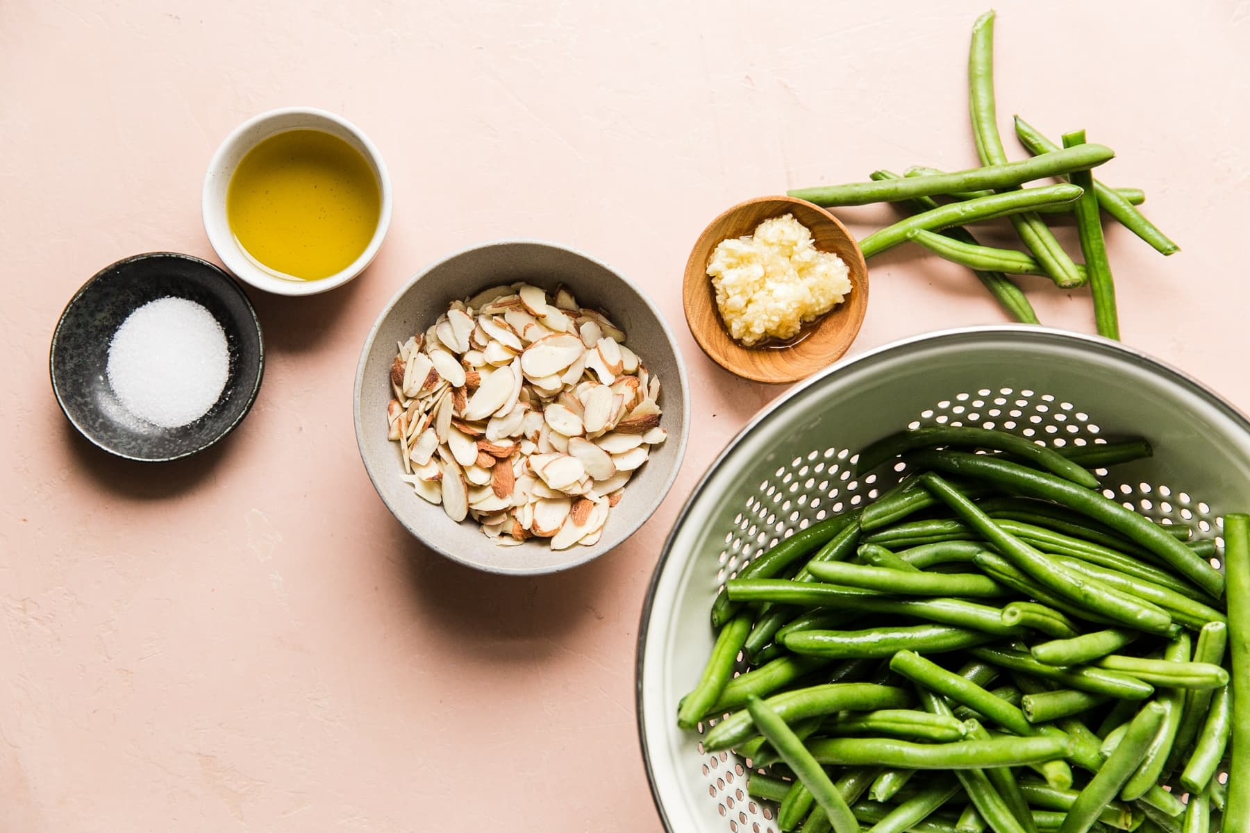 Thanksgiving food recipes meal  ingredients for green bean almondine in small bowls