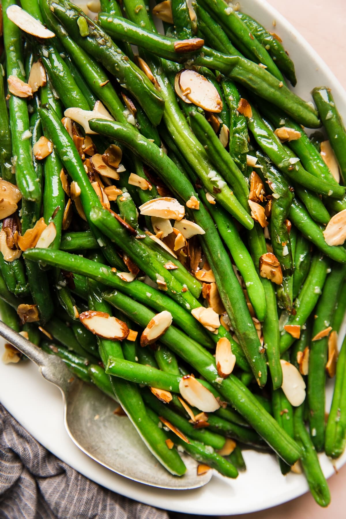 Thanksgiving food recipes meal green bean almondine on a white platter