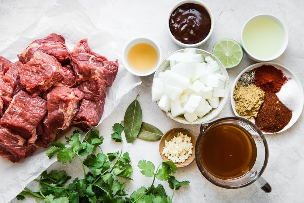 ingredients for Slow Cooker Barbacoa Beef steak, cilantro, stock, spices, garlic